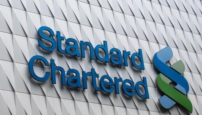 Logo của Standard Chartered tại Hong Kong. (Ảnh: AFP)