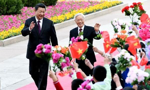 Chủ tịch TQ Tập Cận Bình đón Tổng bí thư Nguyễn Phú Trọng ở TQ hồi tháng 4. Ảnh: THX