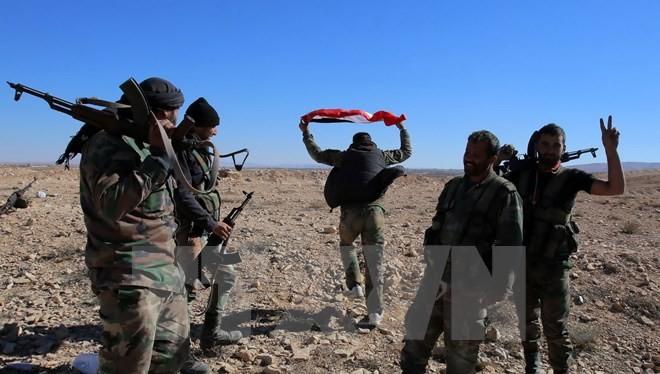 Binh sỹ Syria tại thị trấn Mahin, tỉnh Homs ngày 14/11. (Nguồn: AFP/TTXVN)