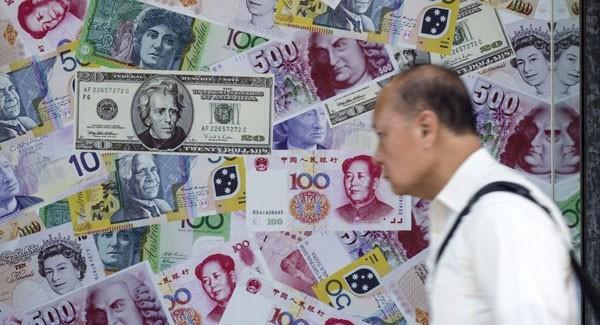 Đồng NDT của Trung Quốc giảm giá mạnh trong năm 2015.