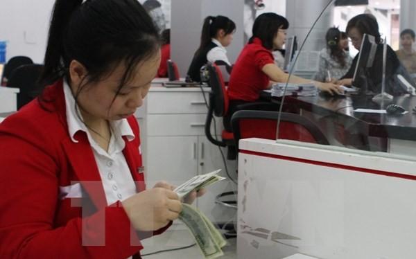 """""""VND có thể giảm 4 đến 5% so với USD trong năm 2016"""""""