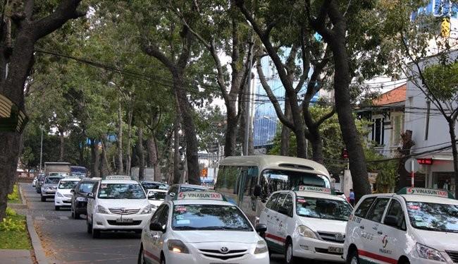 Cước taxi giảm chậm vì DN mất tiền tỉ mỗi lần đổi cước?