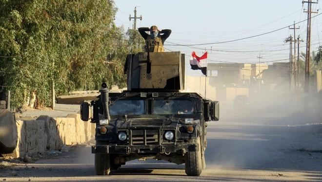 Binh sỹ chống khủng bố Iraq làm nhiệm vụ tại khu vực ngoại ô Ramada ngày 13/1. (Nguồn: AFP/TTXVN)