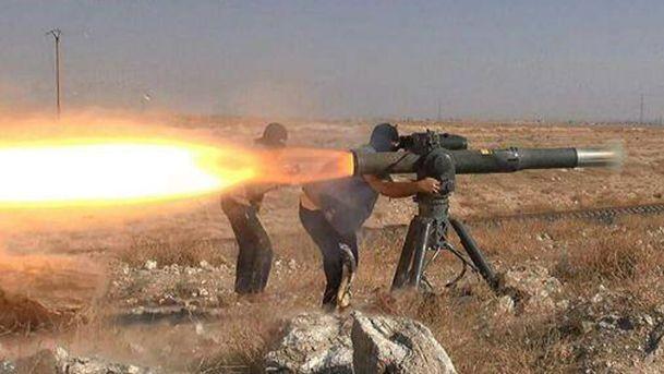 Các phần tử IS khai hỏa tên lửa chống tăng tại Syria. Ảnh: AP