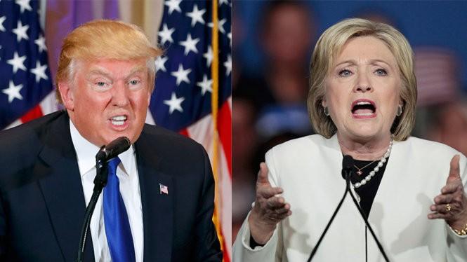 """Ông Donald Trump (trái) và bà Hilary Clinton trong ngày """"Siêu thứ ba"""" - Ảnh: Reuters"""