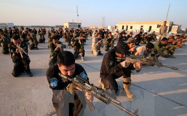 Lực lượng tự vệ Iraq tham gia cuộc diễn tập quân sự ở al-Zubair, gần thành phố miền nam Basra ngày 13/2. (Nguồn: AFP/TTXVN)