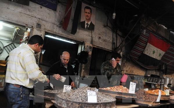Người dân Syria được trở lại hoạt động thường nhật hàng ngày tại Damascus ngày 27/2, sau khi lệnh ngừng bắn có hiệu lực. (Nguồn: THX/TTXVN)