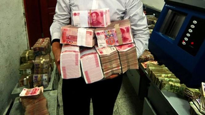Khoảng 1.300 tỉ USD trong các khoản vay của doanh nghiệp Trung Quốc có nguy cơ vỡ nợ - Ảnh: AFP