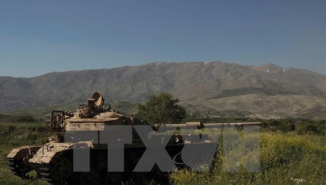 Xe tăng Israel trên vùng đất chiếm đóng của Cao nguyên Golan, giáp giới với làng Hadar của Syria ngày 17/4. (Nguồn: AFP/ TTXVN)