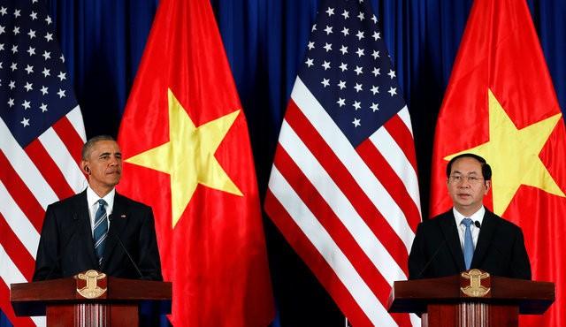 Chủ tịch nước Trần Đại Quang và Tổng thống Obama tại họp báo quốc tế Việt Nam - Hoa Kỳ - Ảnh: Reuters.