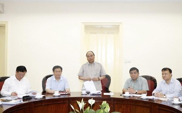 Thủ tướng Nguyễn Xuân Phúc chủ trì cuộc họp. )Ảnh: Thống Nhất/TTXVN)