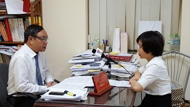 Thẩm phán Trương Việt Toàn trả lời phỏng vấn phóng viên TTXVN. (Ảnh: Nguyễn Cúc/Vietnam+)