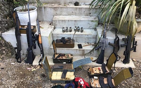 Vũ khí của nhóm tội phạm do cơ quan Công an thu giữ. Ảnh: CAND