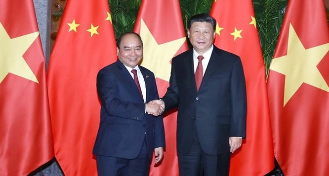 Thủ tướng Nguyễn Xuân Phúc và Tổng Bí thư, Chủ tịch Trung Quốc Tập Cận Bình. Ảnh: VGP