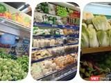 Siêu thị chất đầy hàng hoá thực phẩm nhưng người mua khó đến mua - Ảnh: Hoà Bình