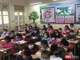 Học sinh tiểu học đeo khẩu trang để phòng bệnh. Ảnh: Lê Mai