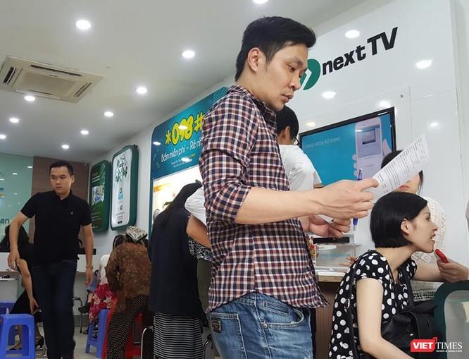 Người dân vẫn đổ xô đăng ký thông tin mặc dù nhà mạng thông báo lùi hạn đăng ký ảnh 10