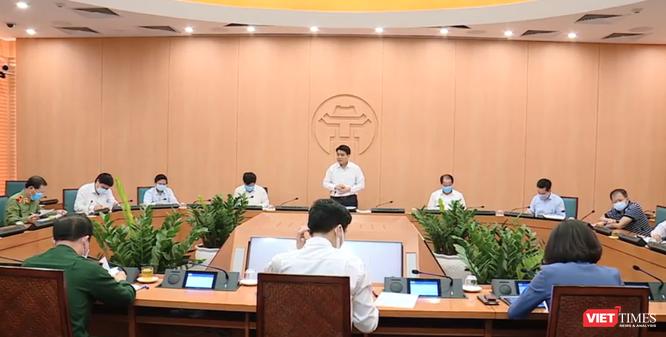 Chủ tịch Hà Nội: Không chờ Bộ Y tế công bố, phải cách ly ngay khi có xét nghiệm dương tính ban đầu với virus Corona ảnh 1