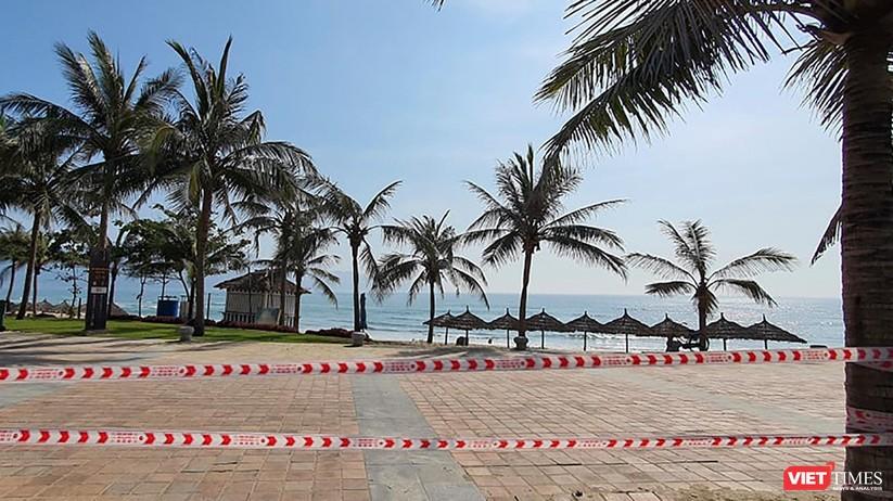 Ảnh: Biển Đà Nẵng vắng bóng người sau khi phát hiện ca mắc COVID-19 mới trong cộng đồng ảnh 7
