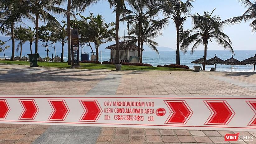 Ảnh: Biển Đà Nẵng vắng bóng người sau khi phát hiện ca mắc COVID-19 mới trong cộng đồng ảnh 3
