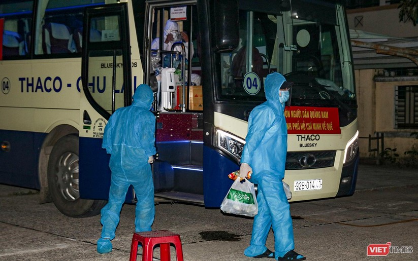 Đoàn xe chở công dân Quảng Nam từ TP HCM trở về quê an toàn ảnh 1