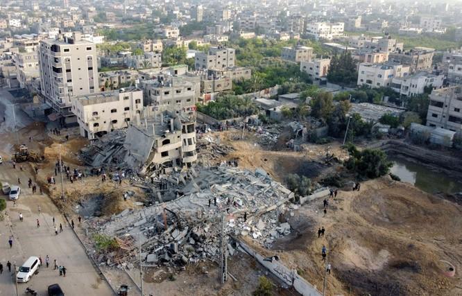 Xung đột Palestine – Israel: Hamas đổi chiến thuật phóng tên lửa; quân đội Israel tấn công mặt đất ảnh 9