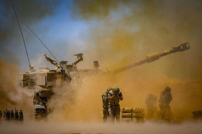 Xung đột Palestine – Israel: Hamas đổi chiến thuật phóng tên lửa; quân đội Israel tấn công mặt đất ảnh 6