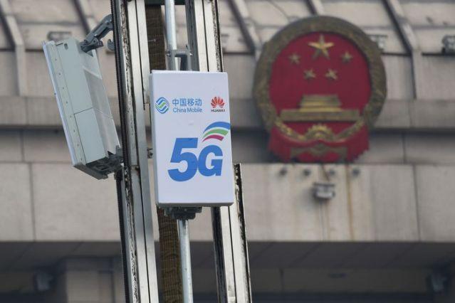 Bắc Kinh tuyên bố trả đũa việc Mỹ hủy niêm yết các công ty viễn thông Trung Quốc ảnh 1
