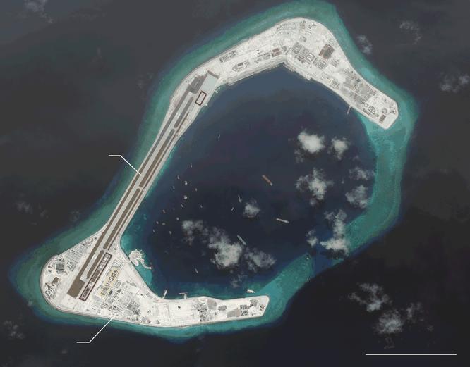 Cận cảnh Đá Xu bi đã bị Trung Quốc bồi lấp, xây đảo nhân tạo trái phép với đường băng và các nhà chứa máy bay tại quần đảo Trường Sa