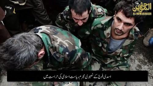 IS dùng xe máy kéo xác 3 binh sĩ Syria khắp Raqqa ảnh 1