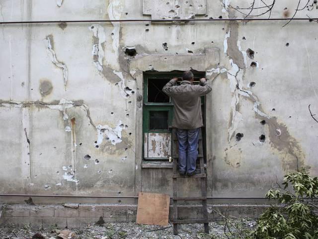 """""""Chảo lửa"""" Debaltsevo tan hoang sau trận huyết chiến khốc liệt ảnh 1"""