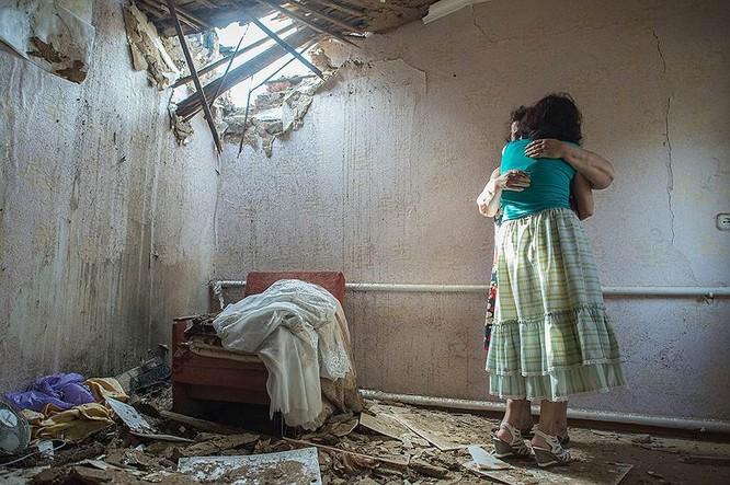 Cận cảnh xung đột Ukraine: một năm thảm họa ảnh 26