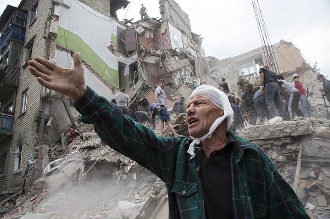 Cận cảnh xung đột Ukraine: một năm thảm họa ảnh 36