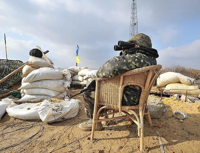 Cận cảnh xung đột Ukraine: một năm thảm họa ảnh 63