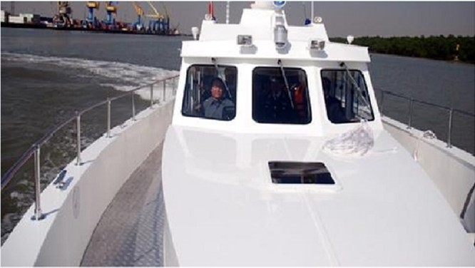 Cảnh sát biển Việt Nam đóng xuồng chống đạn ảnh 1