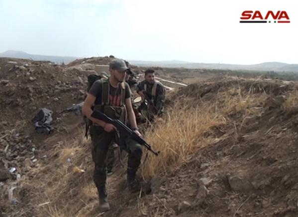 Chiến trận giằng co ác liệt giữa quân đội Syria và chiến binh IS, en - Nursa ảnh 31