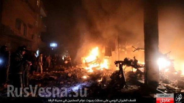 Máy bay lạ tấn công dữ dội thủ phủ IS ở Syria ảnh 7
