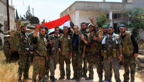 Sau hai ngày bão lửa, dân quân Syria chiếm lại thị trấn chiến lược ảnh 2