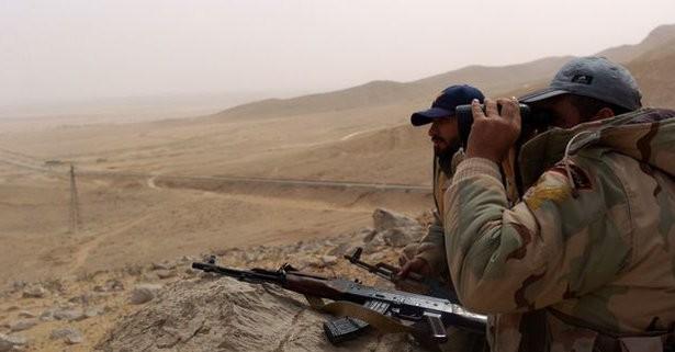 Video + Ảnh: Ác liệt trận chiến giành thành phố cổ Palmyra ảnh 6