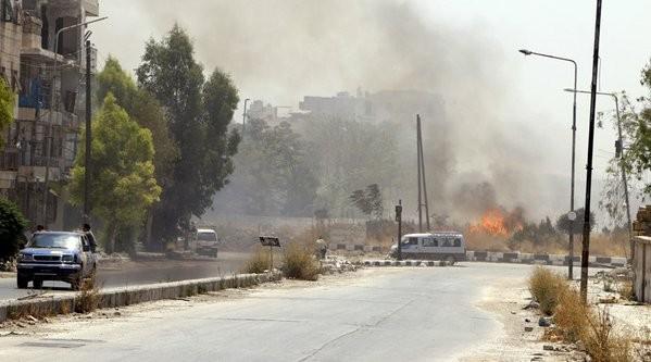 Video + Ảnh: Ác liệt trận chiến giành thành phố cổ Palmyra ảnh 10