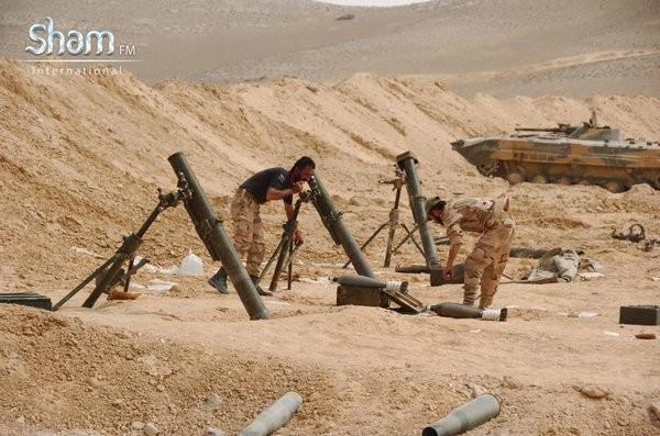 Video + Ảnh: Ác liệt trận chiến giành thành phố cổ Palmyra ảnh 18