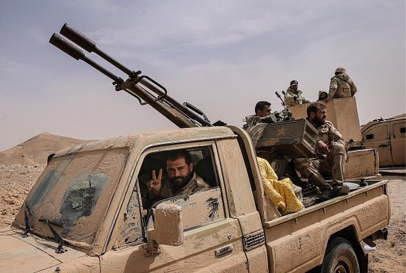 Video + Ảnh: Ác liệt trận chiến giành thành phố cổ Palmyra ảnh 31