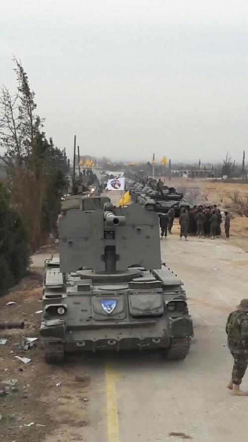 Quân Hezbollah ở Syria diễu hành mừng chiến thắng Aleppo ảnh 5