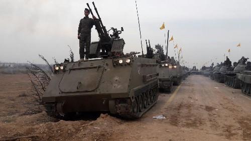 Quân Hezbollah ở Syria diễu hành mừng chiến thắng Aleppo ảnh 6