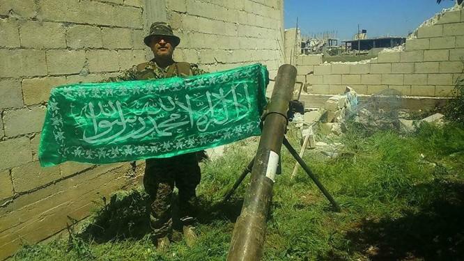 Quân đội Syria hủy diệt hàng chục xe phiến quân, hơn 50 tay súng thánh chiến chết trận (video) ảnh 9