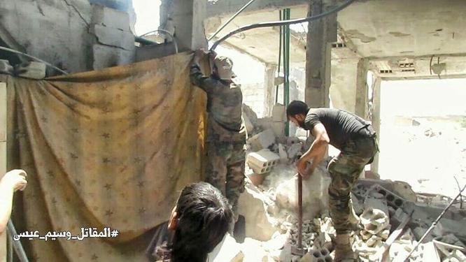 Quân đội Syria đánh phá dữ dội các quận ngoại ô Damascus (video) ảnh 8