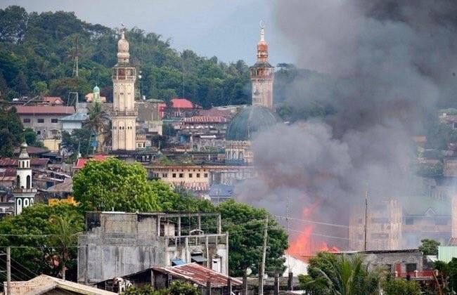 Quân đội Philippines tiêu diệt 61 tay súng IS trong chiến dịch tái chiếm Marawi (chùm video) ảnh 1