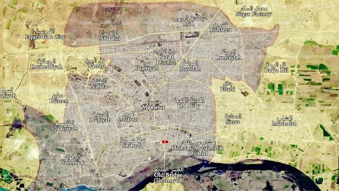 """Chiến sự Syria: Người Kurd bao vây """"thủ đô"""" của IS ảnh 1"""