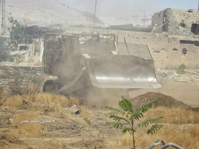 Quân đội Syria tấn công dữ dội phe thánh chiến cố thủ đông Damascus ảnh 10