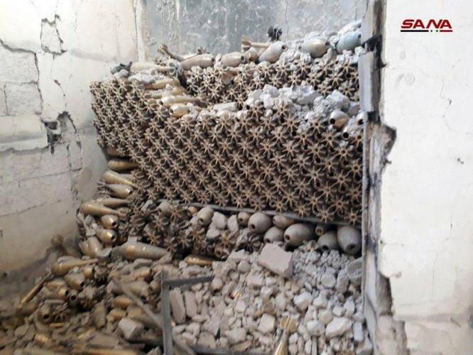 Quân đội Syria phát hiện kho đạn cối khổng lồ của phe thánh chiến tại tử địa Đông Ghouta ảnh 5